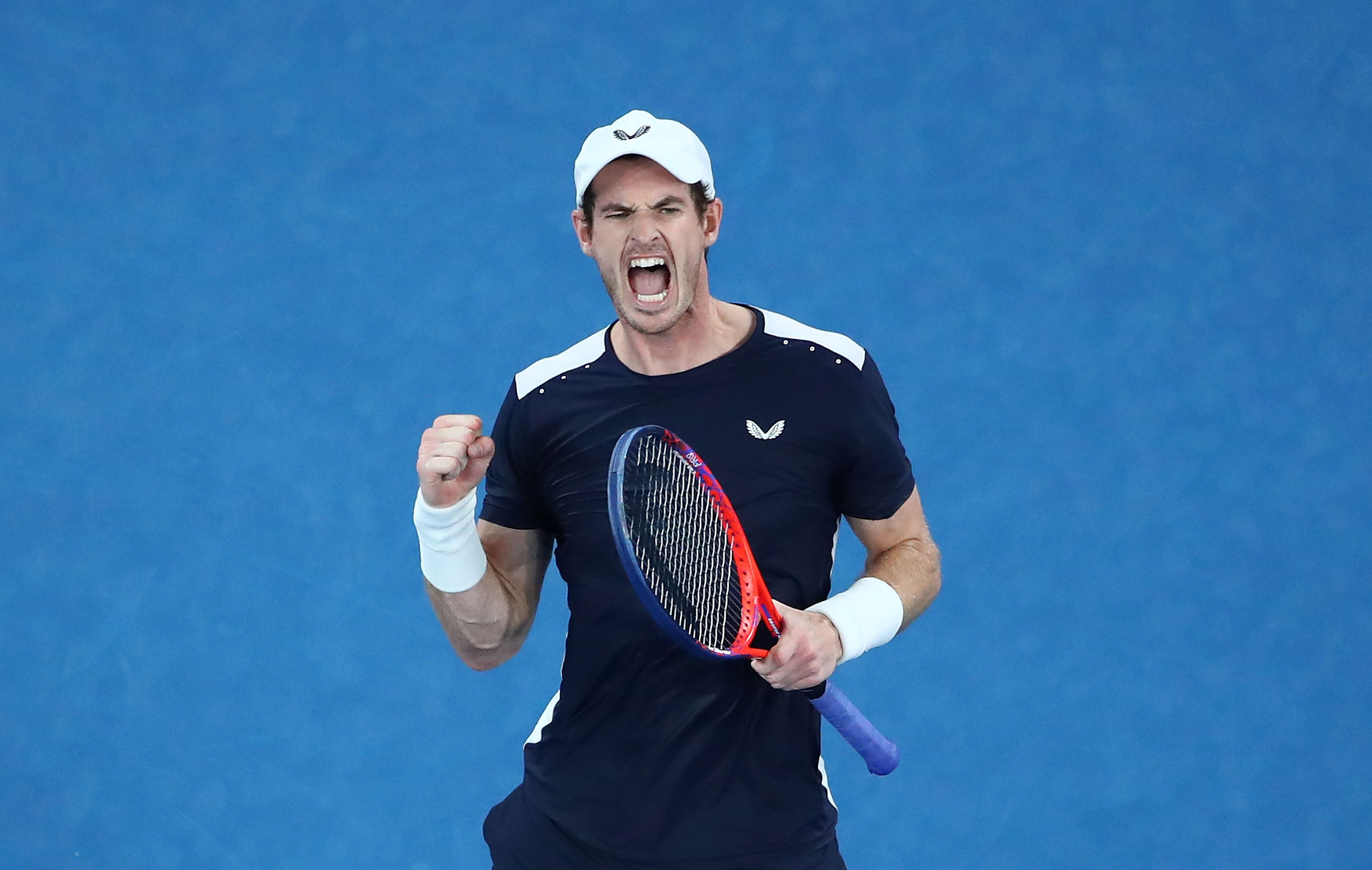 MELBOURNE, AUSTRALIA - JANUARY 14:  Andy Murray of Great Britain celebrates winning the third set in his first round match against Roberto Bautista Agut of Spain during day one of the 2019 Australian Open at Melbourne Park on January 14, 2019 in Melbourne, Australia. (Photo by Scott Barbour/Getty Images)