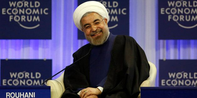 Iran's President Hassan Rouhani smiles during a session at the annual meeting of the World Economic Forum (WEF) in Davos Janu