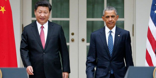 President Barack Obama and Chinese President Xi Jinping arrive for their joint new conference, Friday, Sept. 25,2015, in the