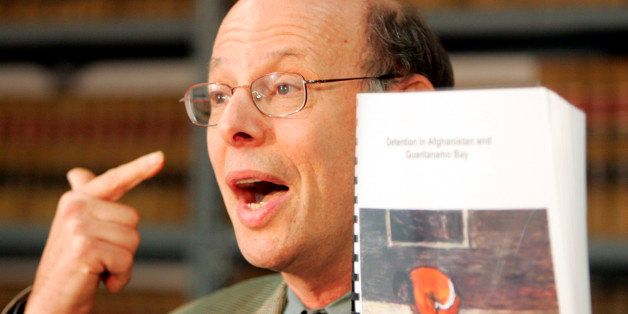 Michael Ratner, President of the Center for Constitutional Rights, holds a copy of a report on conditions at the Guantanamo B