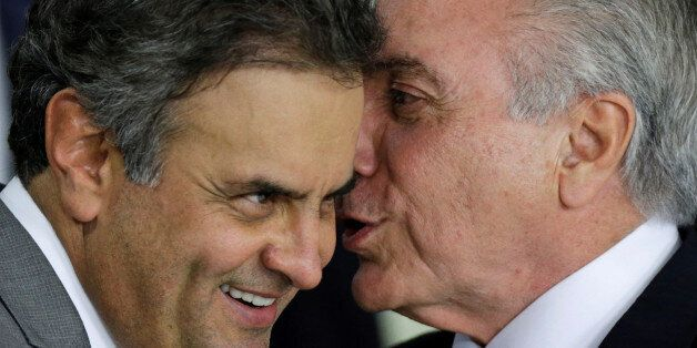 Brazil's interim President Michel Temer (R) talks with Senator Aecio Neves during a ceremony where he made his first public r
