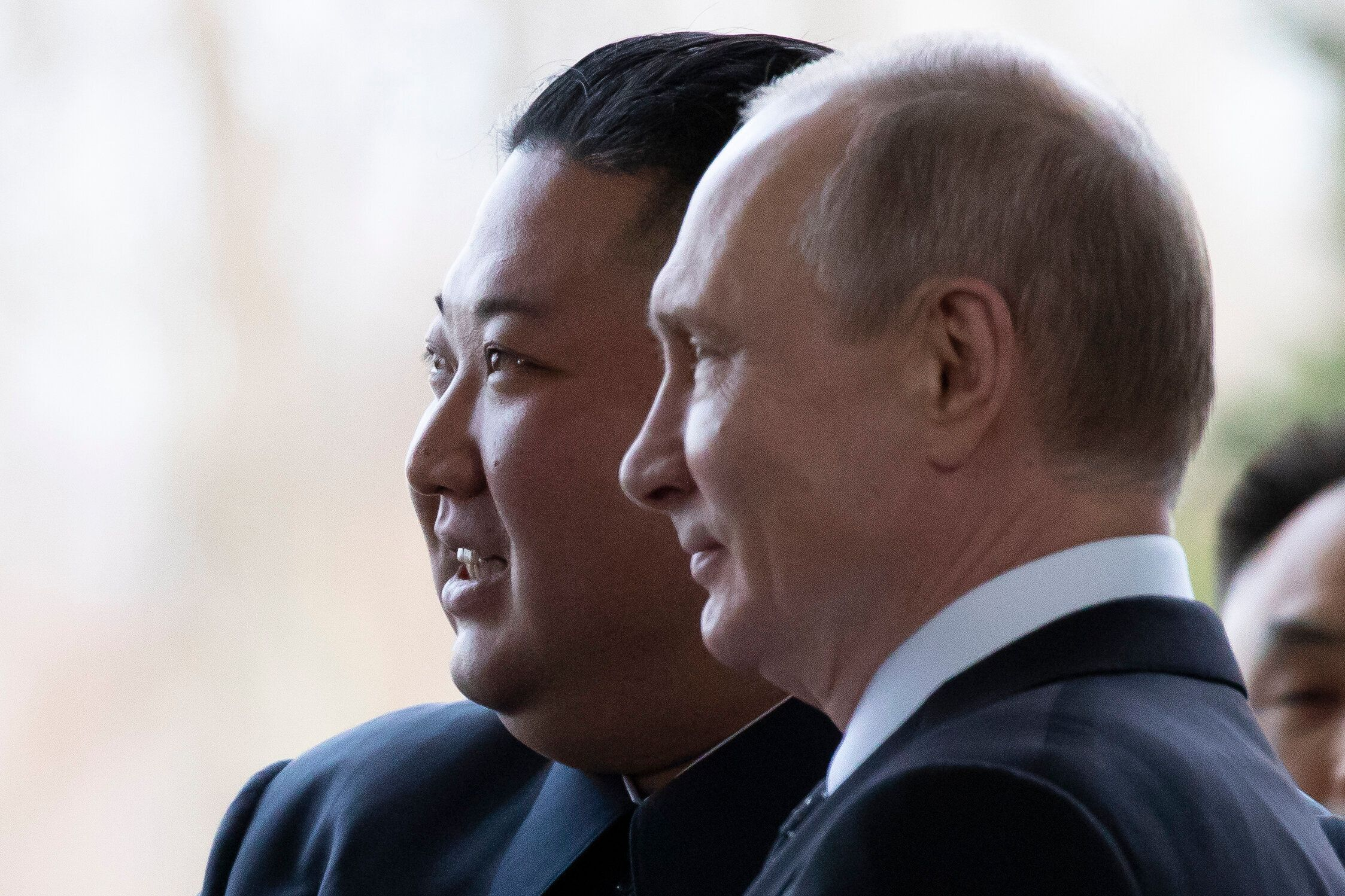 Russian President Vladimir Putin, right, and North Korea's leader Kim Jong Un pose for a photo prior to their talks in Vladiv