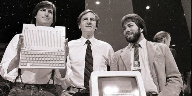 FILE - In this April 24, 1984, file photo, Steve Jobs, left, chairman of Apple Computers, John Sculley,...
