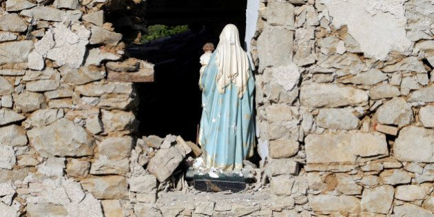 A Virgin Mary statue is seen in a church following an earthquake at Cossito near Amatrice, central Italy,...