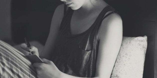Young woman writing diary in