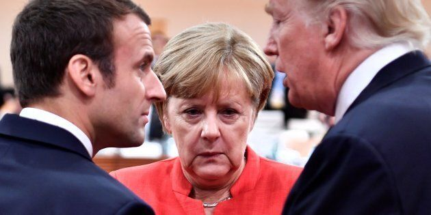 French President Emmanuel Macron, German Chancellor Angela Merkel and U.S. President Donald Trump confer...