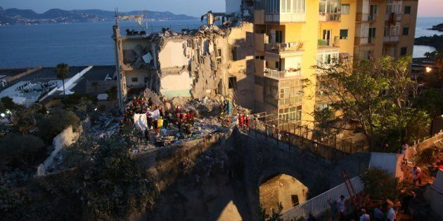 Rescuers at work amid the rubble of a building that collapsed in Torre Annunziata, near Naples, southern...