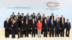 Amburgo peggio di Taormina, il G20 fa marcia indietro su commercio, clima, Ucraina. Niente sui migranti. E la città è devasta...