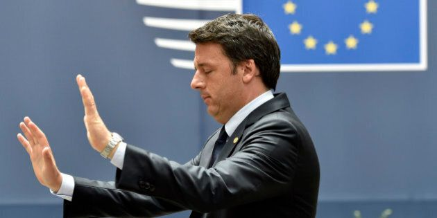 Italian Prime Minister Matteo Renzi gestures as he leaves the EU Summit in Brussels, Belgium, June 28,...