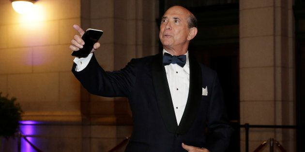 Republican National Committee finance chairman Lewis Eisenberg arrives to attend a candlelight dinner...