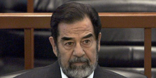 FILE - In this Dec. 6, 2006 file photo, former Iraq leader Saddam Hussein sits in court in Baghdad, Iraq,...