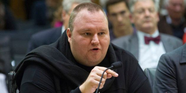 FILE - In this Wednesday, July 3, 2013 file photo, Internet entrepreneur Kim Dotcom speaks during the...