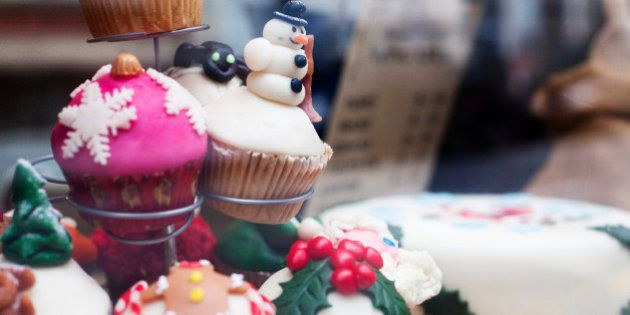 nice decorated Christmas muffins with a snowman on display in a
