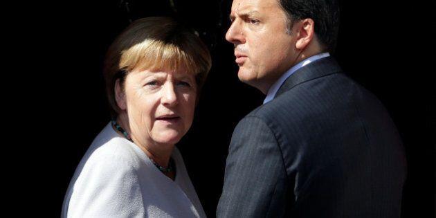 Italian Prime Minister Matteo Renzi (R) and German Chancellor Angela Merkel arrive for a regular Italo-German...