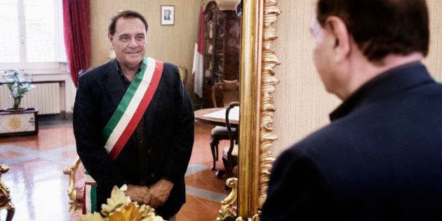 Politician Clemente Mastella, Mayor of Benevento, in front of a mirror in his office. Benevento, Italy....