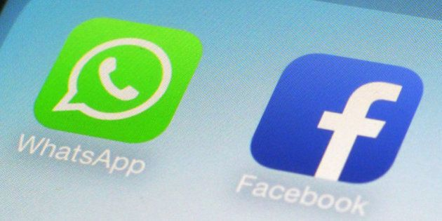 FILE - This Feb. 19, 2014, file photo, shows WhatsApp and Facebook app icons on a smartphone in New York....