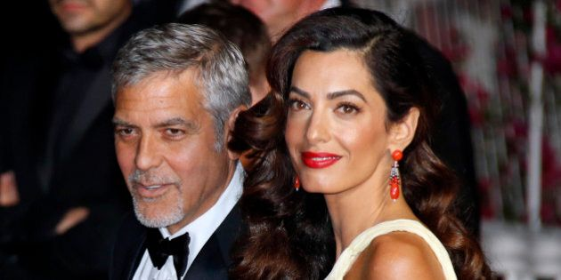Cast member George Clooney and his wife Amal leave the Festival Palace after the screening of the