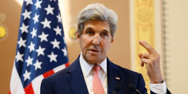 U.S. Secretary of State John Kerry gestures as he speaks during a press conference with Britain's Foreign...