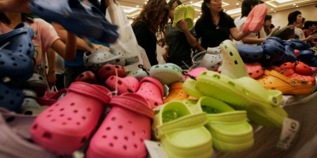 Shoppers choose for clogs during the sale for Crocs footwear at Senayan City shopping mall in Jakarta,...