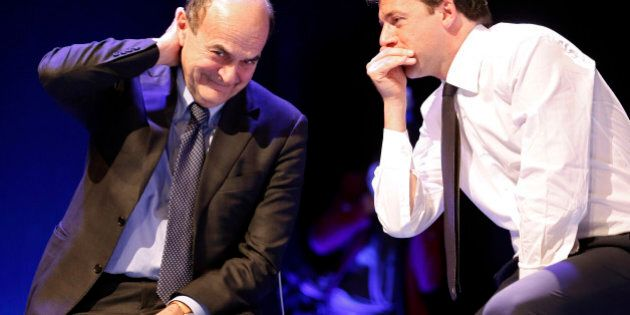 Italian PD (Democratic Party) leader Pierluigi Bersani (L) talks with Mayor of Florence Matteo Renzi...
