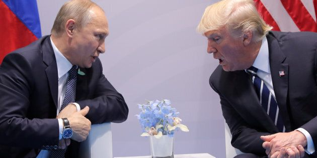 U.S. President Donald Trump speaks with Russian President Vladimir Putin during the their bilateral meeting...