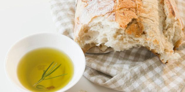 Close up of bread and olive oil on