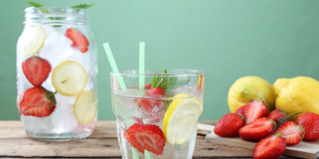 ice long drink strawberry and lemon in glass green