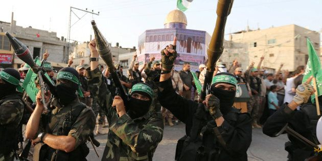 Palestinian Hamas militants take part in a military show against Israel's newly-installed security measures...