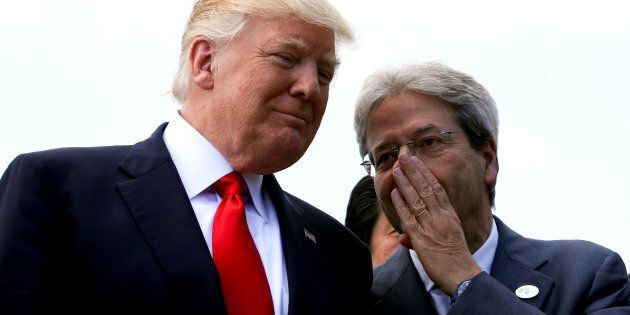 Italian Prime Minister Paolo Gentiloni speaks to U.S. President Donald Trump during a family photo at...