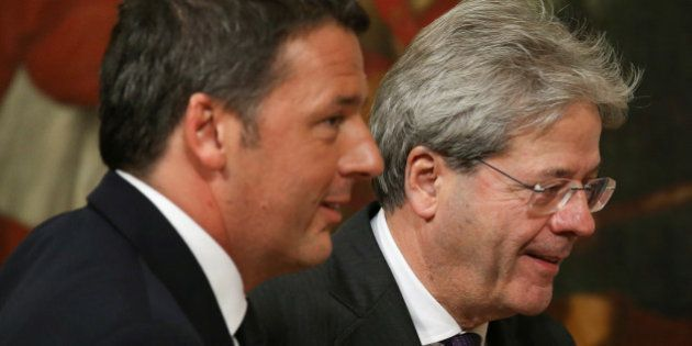 Newly appointed Italian Prime Minister Paolo Gentiloni (R) and his predecessor Matteo Renzi arrive to...