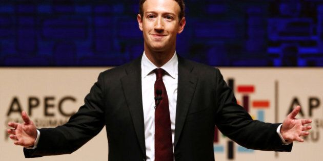 Mark Zuckerberg gestures while addressing the audience during a meeting of the APEC (Asia-Pacific Economic...