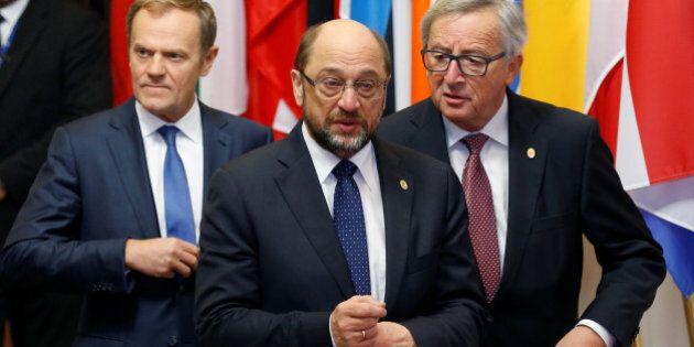 European Parliament President Martin Schulz walks with European Council President Donald Tusk (L) and...