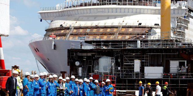 STX workers gather before a visit by French President Emmanuel Macron at the STX Les Chantiers de l'Atlantique...