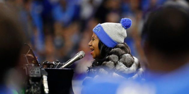 Aretha Franklin performs the national anthem before the first half of an NFL football game between the...