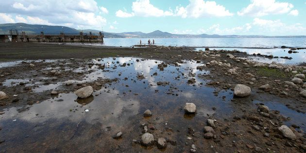 Sandspits that emerged due to the drought are seen in the lake of Bracciano, north of Rome, Italy July...