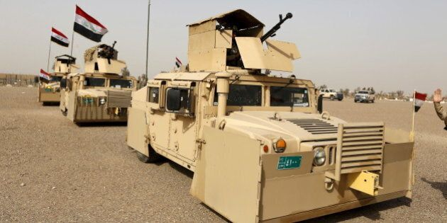 Iraqi security forces ride in vehicles travelling to Mosul to fight against militants of Islamic State...