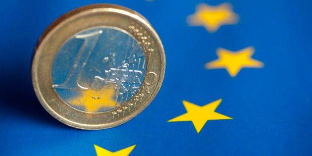 A one euro coin on flag of