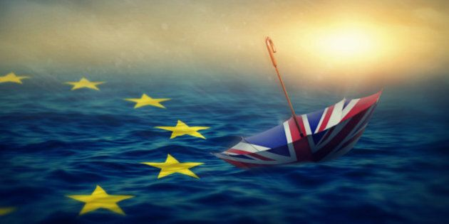 Umbrella with the flag of the United Kingdom and sea with the flag European Union.Brexit