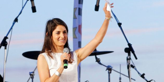 Candidate as Rome's mayor Virginia Raggi, of the 5-Star Movement, waves to supporters during a final...