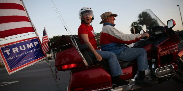 KENDALL, FL - MARCH 09: Supporters of Repubican presidential candidate Donald Trump drive their motorcycle...