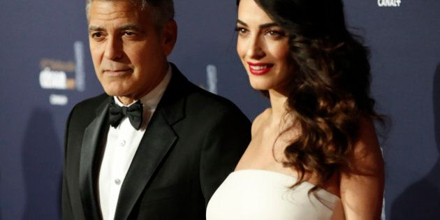 aca8e704c057 Actor George Clooney and his wife Amal pose as they arrive at the 42nd  Cesar Awards