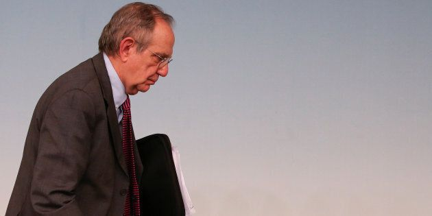 Italy's Economy Minister Pier Carlo Padoan leaves at the end of a news conference at Chigi Palace in...