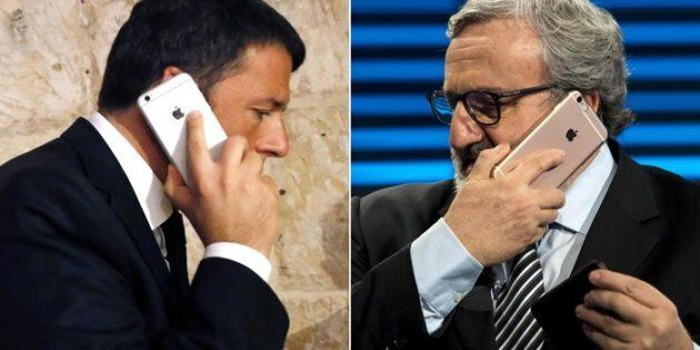 Italian Prime Minister Matteo Renzi uses his mobile phone prior to the start of the second day of the...