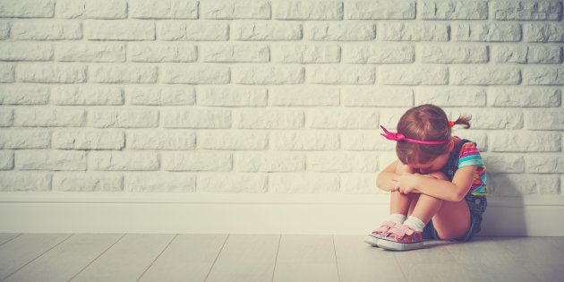 little child girl crying and sad about an empty brick