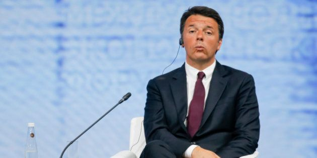 Italian Premier Matteo Renzi listens to Russian President Vladimir Putin speaking at the St. Petersburg...