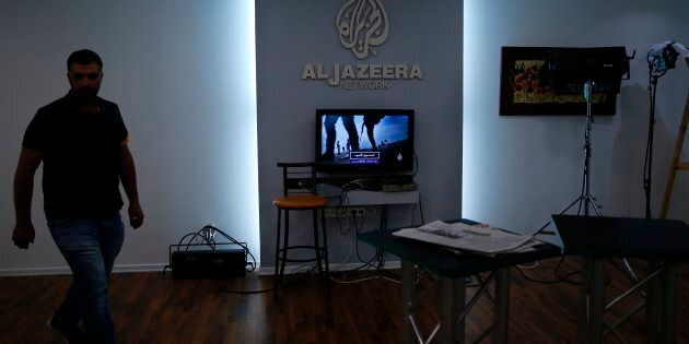 Employees of Qatar based news network and TV channel Al-Jazeera are seen at their Jerusalem office on...