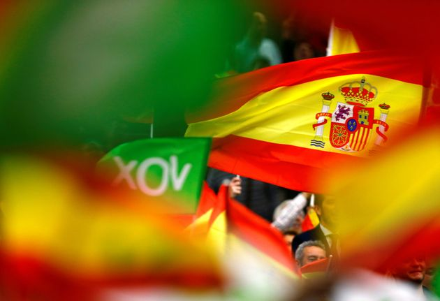 Spain's far-right party VOX supporters wave Spanish flags during an electoral rally ahead of general...