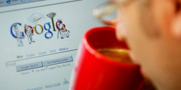 An internet surfer views the Google home page at a cafe in London, August 13, 2004. Google Inc. on Friday...
