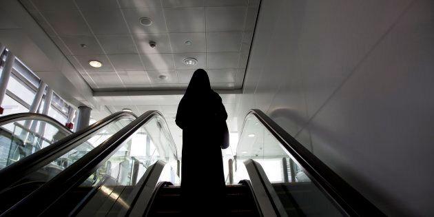 United Arab Emirates, Dubai, Arab Woman in a Hijab Walking
