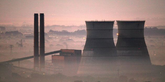 Early morning smog shrouds cooling towers of a power plant in Cape Town, South Africa, June 8, 2006....